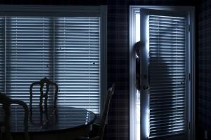 Stranger looking in through an open door